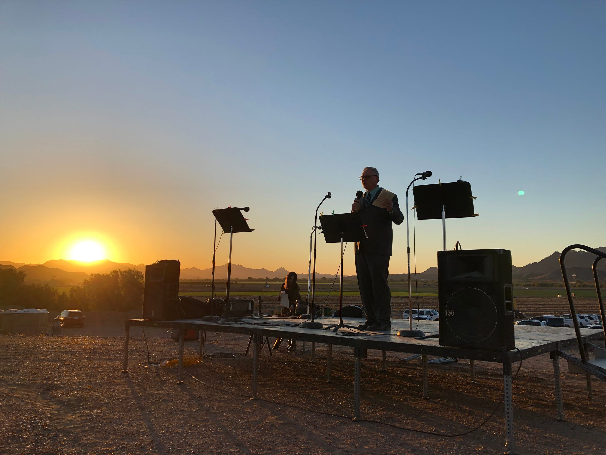 The sun rises over Dome Valley as Cecil Pratt delivers his Easter sermon.