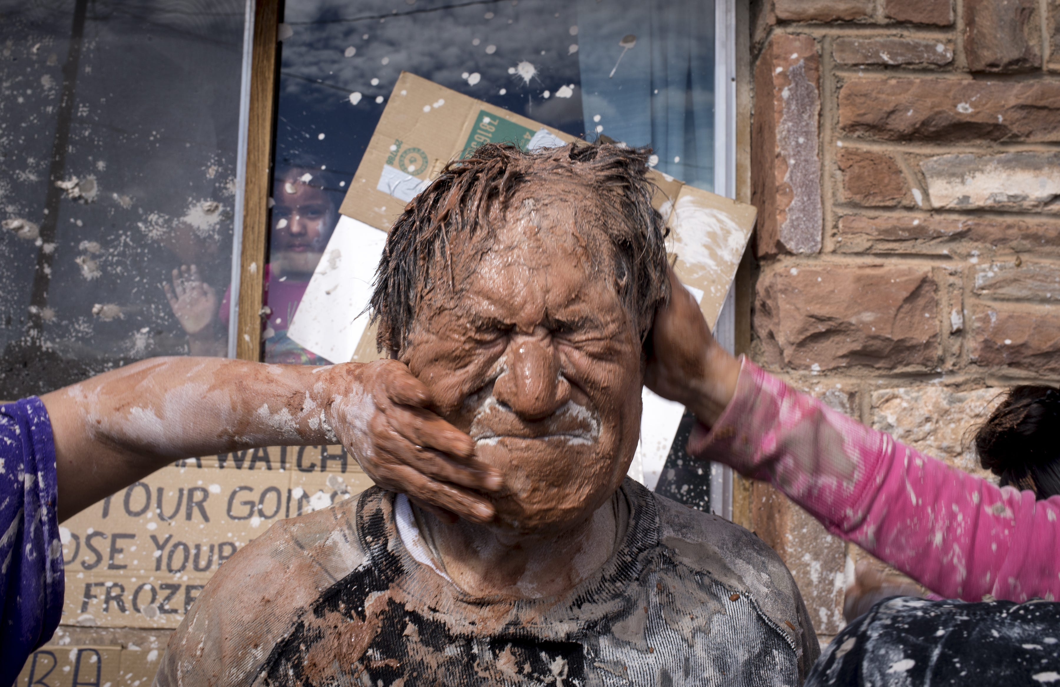 Bunny Coriz (the groom's dad) is covered in mud during the mud fight.