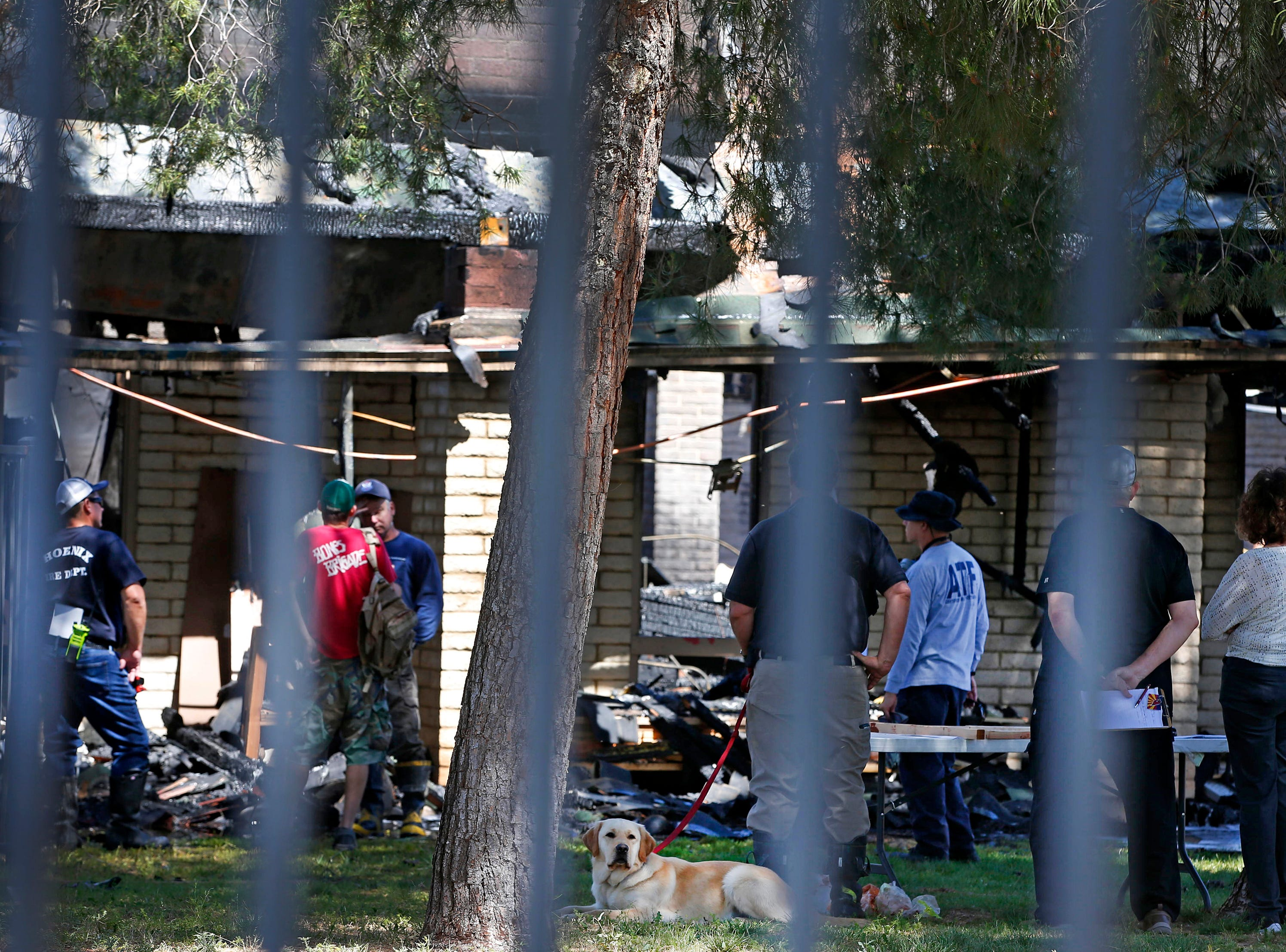 Investigators work the scene at St. Joseph Catholic Church in Phoenix on May 1, 2019, after a fire destroyed most of the church.