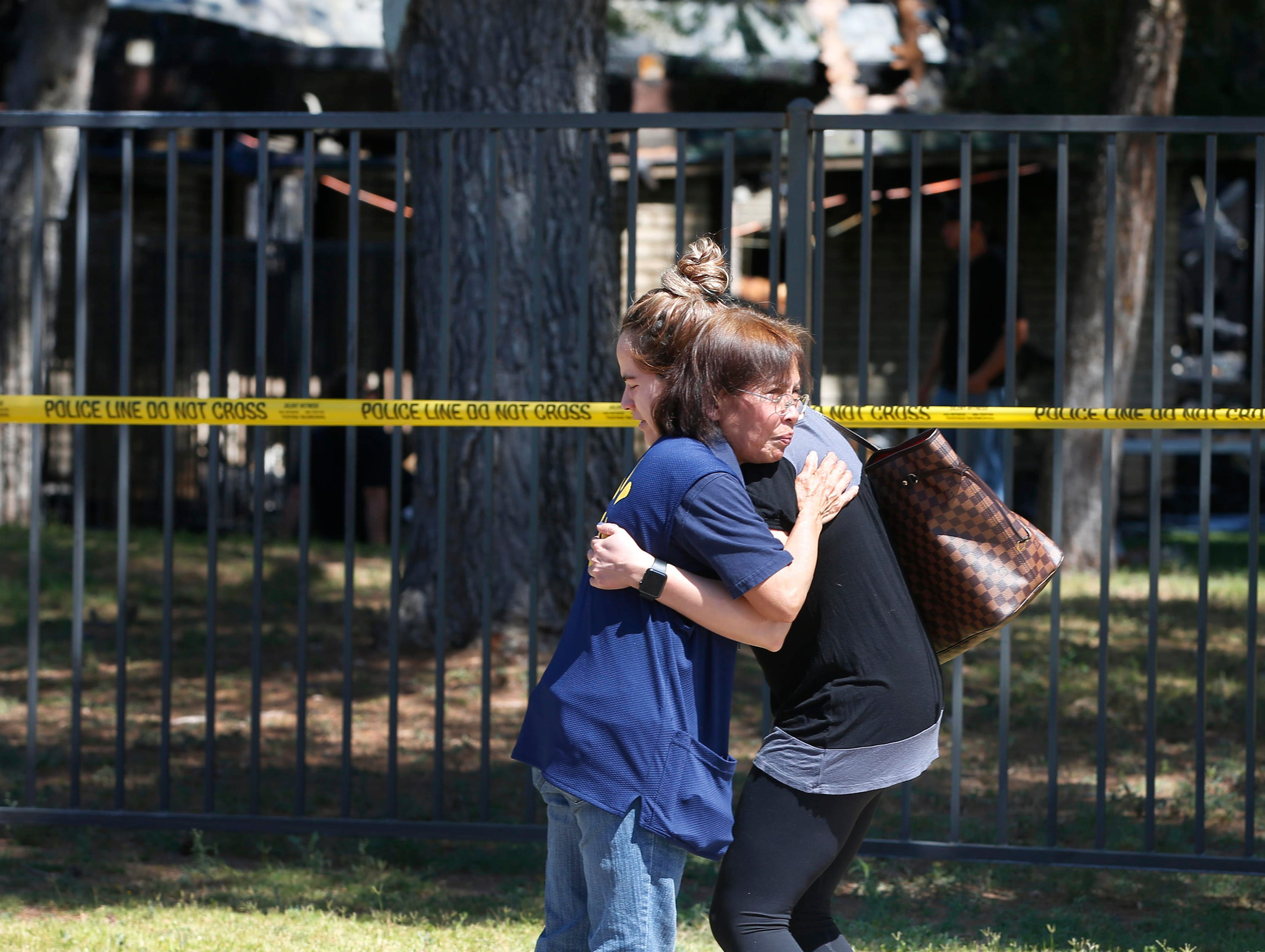 Parishioner Virginia Legarce (left) and Meredith Sanchez, Castillo console each other outside St. Joseph Catholic Church in Phoenix on May 1, 2019, after a fire destroyed most of the church.