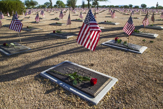 A single rose adorns the grave of a veteran at the National Memorial Cemetery in Phoenix on May 30, 2016, Memorial Day.