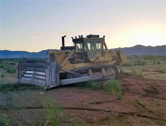 A Kingman man is accused of stealing this bulldozer and using it to carve up roads and destroy mailboxes.