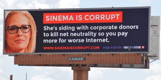Net neutrality activist group Fight for the Future crowdfunded a billboard criticizing Sen. Kyrsten Sinema's opposition of the Save the Internet Act.