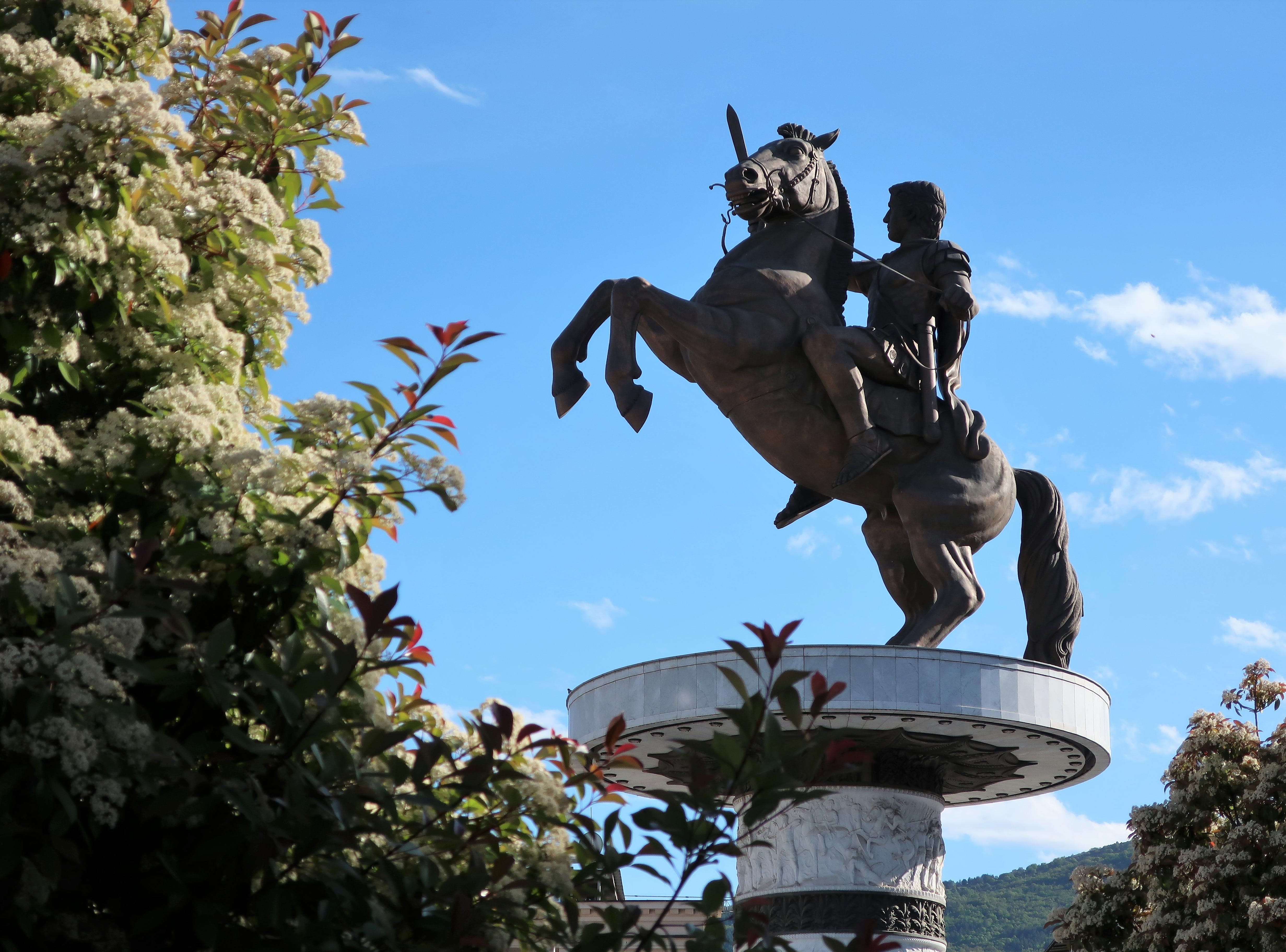 The controversial statue of Alexander the Great rides high over downtown Skopje, North Macedonia.