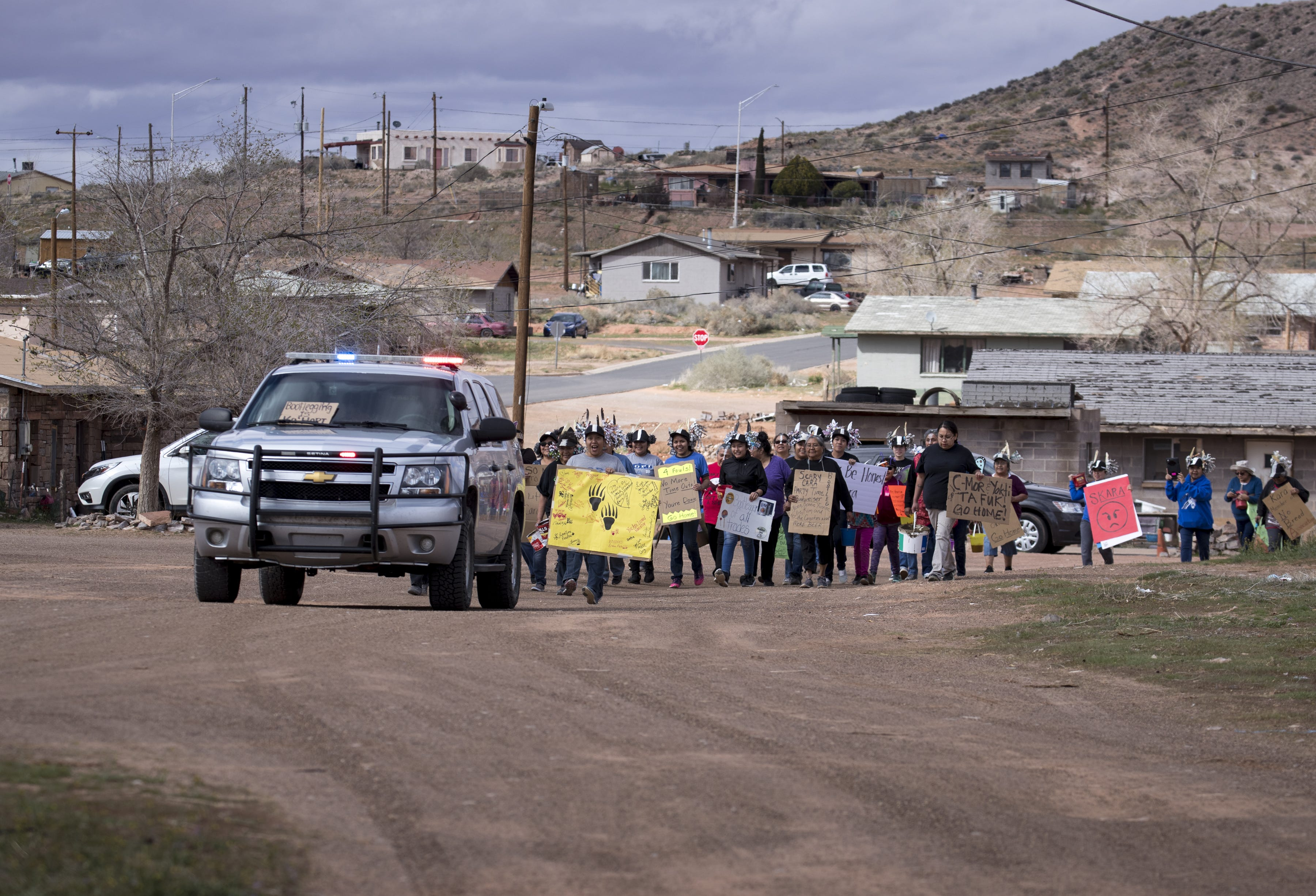 A Hopi police vehicle leads dozens of relatives to Lester Honanveama's family home for a mud fight on March 22, 2019, in Moenkopi, Arizona.
