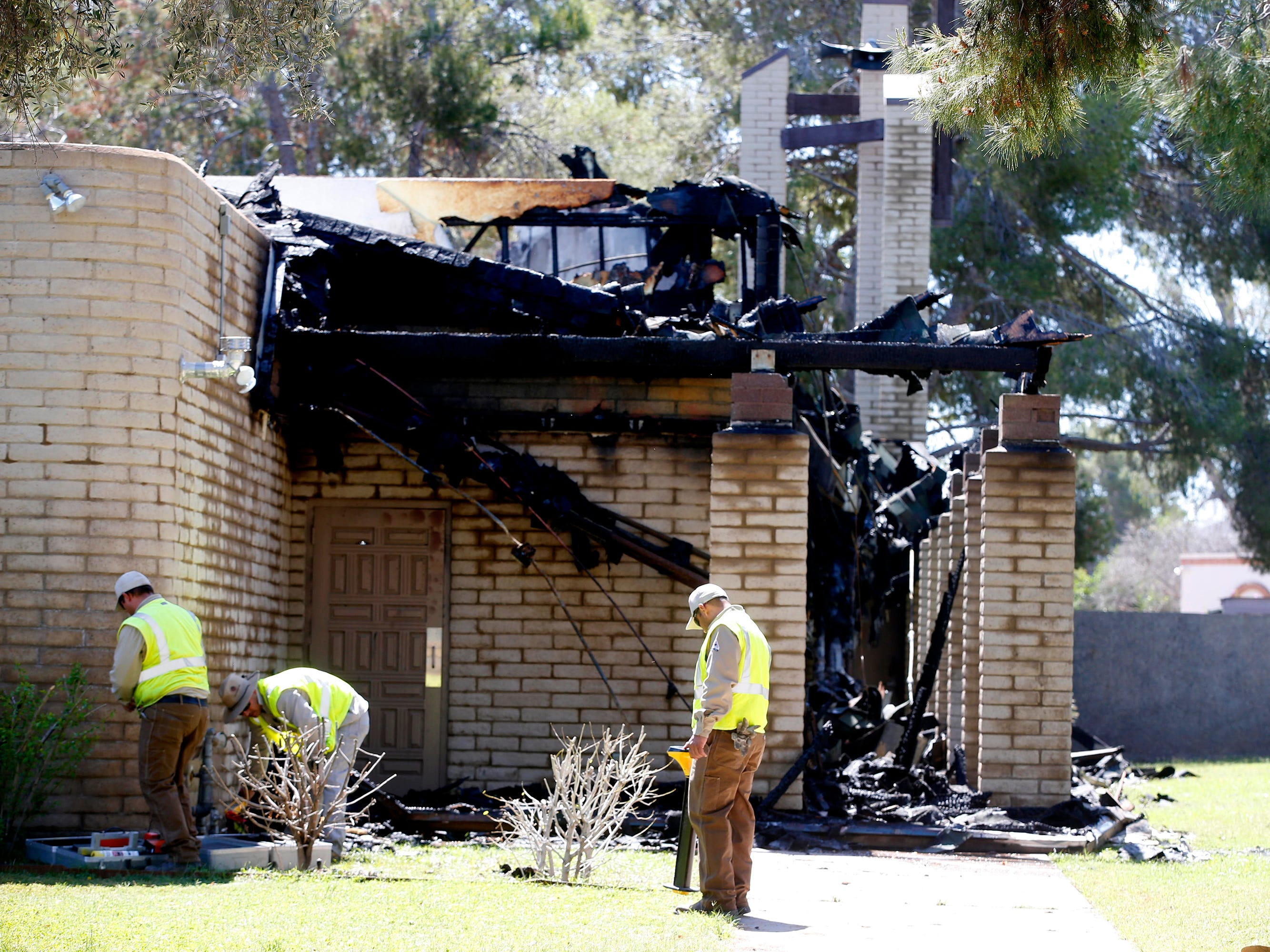 Crews work the scene at St. Joseph Catholic Church in Phoenix on May 1, 2019, after a fire destroyed most of the church.