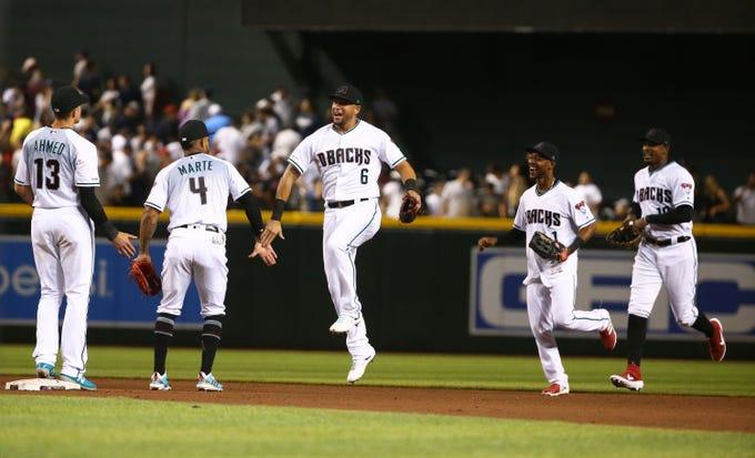 The Arizona Diamondbacks' David Peralta (6) celebrates after defeating the New York Yankees 3-1 on Apr. 30, 2019 at Chase Field in Phoenix, Ariz.