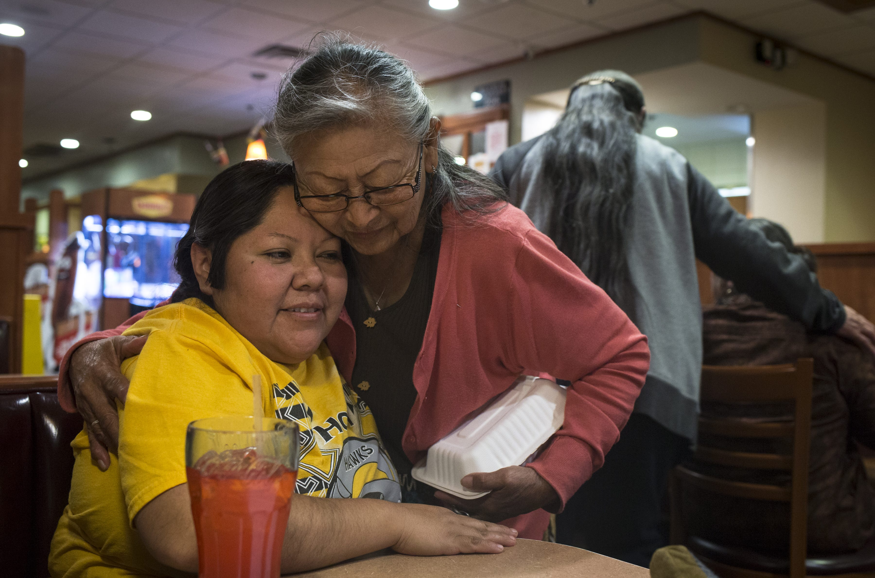 Kara is hugged by her auntie, Tresa Sufkie. Kara and Lester and their family had dinner at Denny's in Tuba City after the 10-day wedding ended on March 28, 2019.