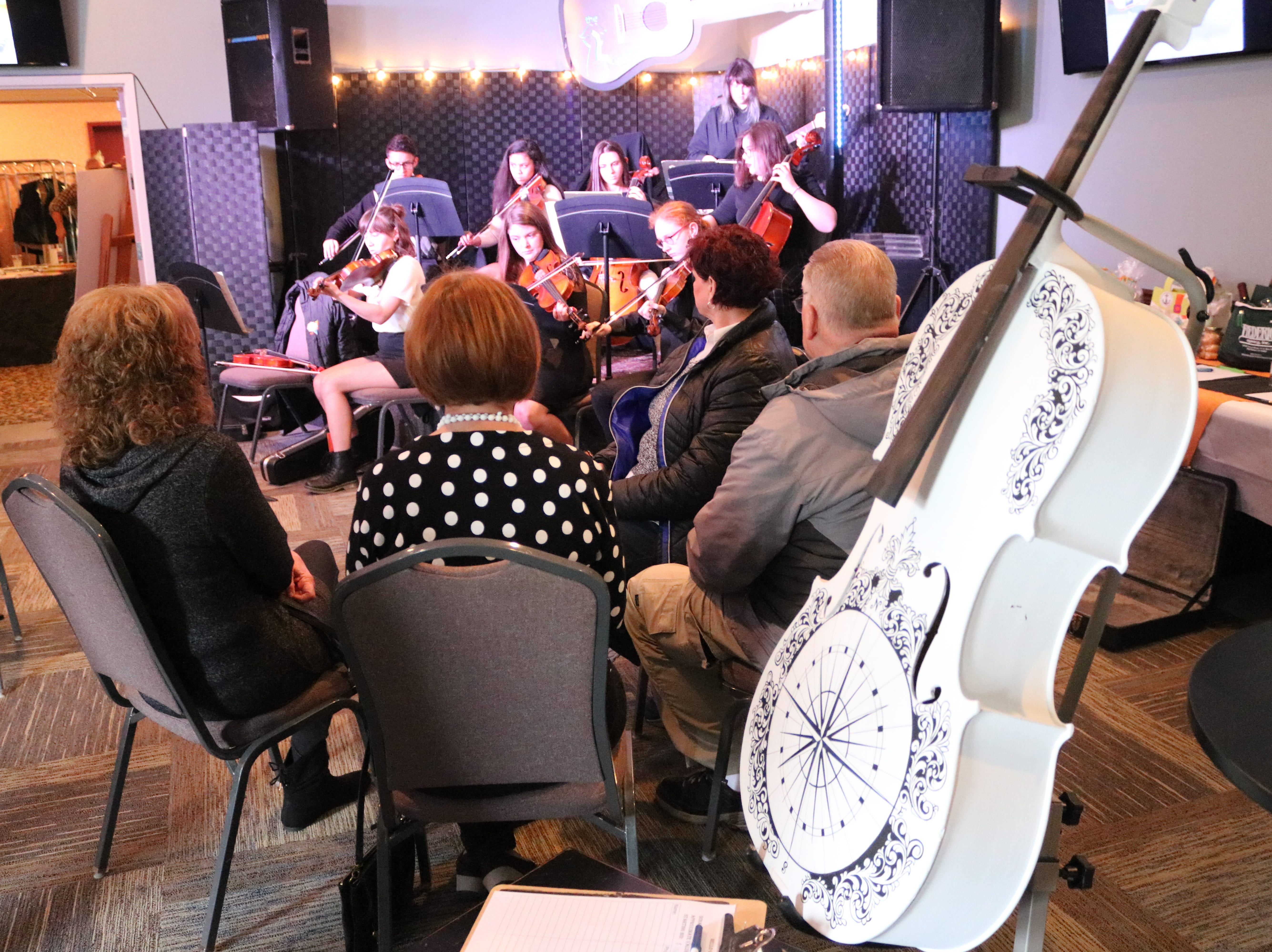 Four cellos, each hand-painted with a one-of-a-kind design by local artists, were donated and sold in silent auction as the focal point of the GPCAAC's Mello Cellos fundraiser on Tuesday.