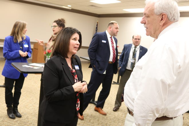 Director of the United Way in Ottawa County, Stacy Maple, left, speaks with Ottawa County Municipal Court Magistrate Lou Wargo during a community meet and greet event.