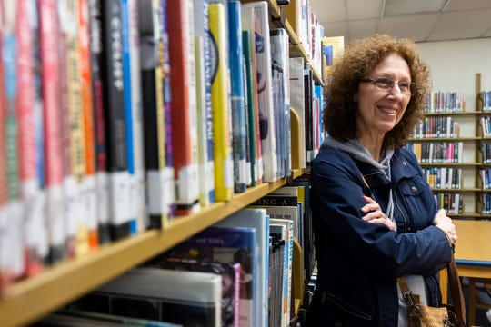 Peggy Lawton takes a moment from browsing for books at St. Clair County Library's main branch Wednesday, May 1, 2019 in Port Huron.