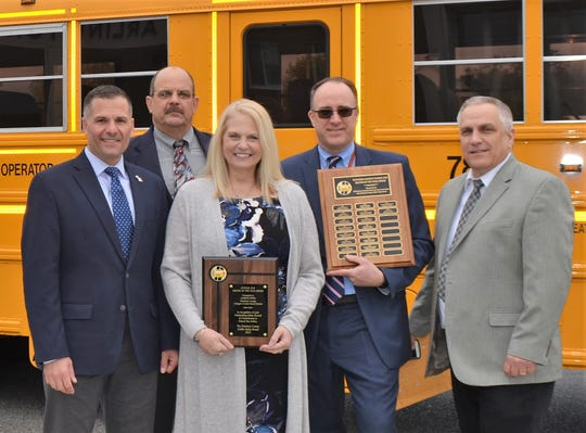 Janice Tito (center) displays a plaque naming her Dutchess County School Bus Driver of the Year.