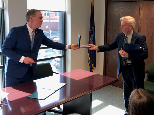 Robert Hargrave accepts a Purple Heart from U.S. Rep. John Joyce on behalf of his late brother, Private First-Class John Hargrave, who was killed April 1, 1967, in the Vietnam War. The presentation took place Monday, April 29, in Joyce's Chambersburg office.