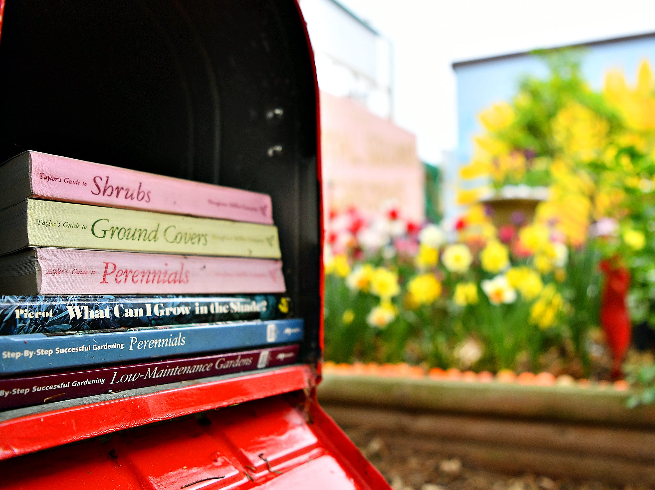 Gardening books rest in the library at Royal Square Garden in York City, Wednesday, May 1, 2019. Dawn J. Sagert photo