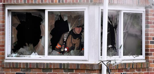 Firefighters break out the first floor windows at the scene of a house fire in the 2200 block of W. Philadelphia Street in West Manchester Township, Wednesday, May 1, 2019. John A. Pavoncello photo