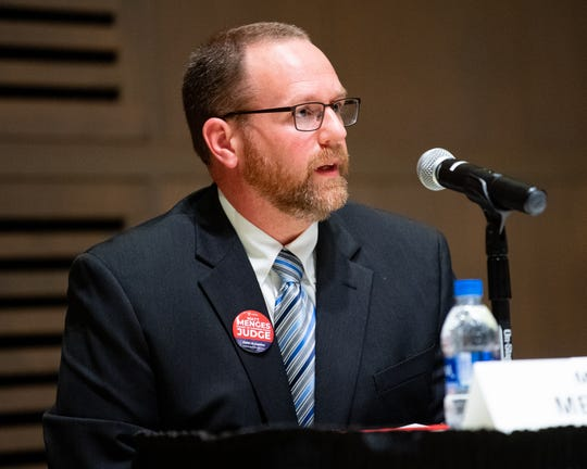Matt Menges, who's one of three candidates running for a position on the York County Court of Common Pleas, answers a question on Tuesday during a judicial forum at York College.
