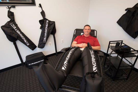 YDR reporter John Buffone receives a round of leg compression therapy at South Central Chiropractic in Shrewsbury.