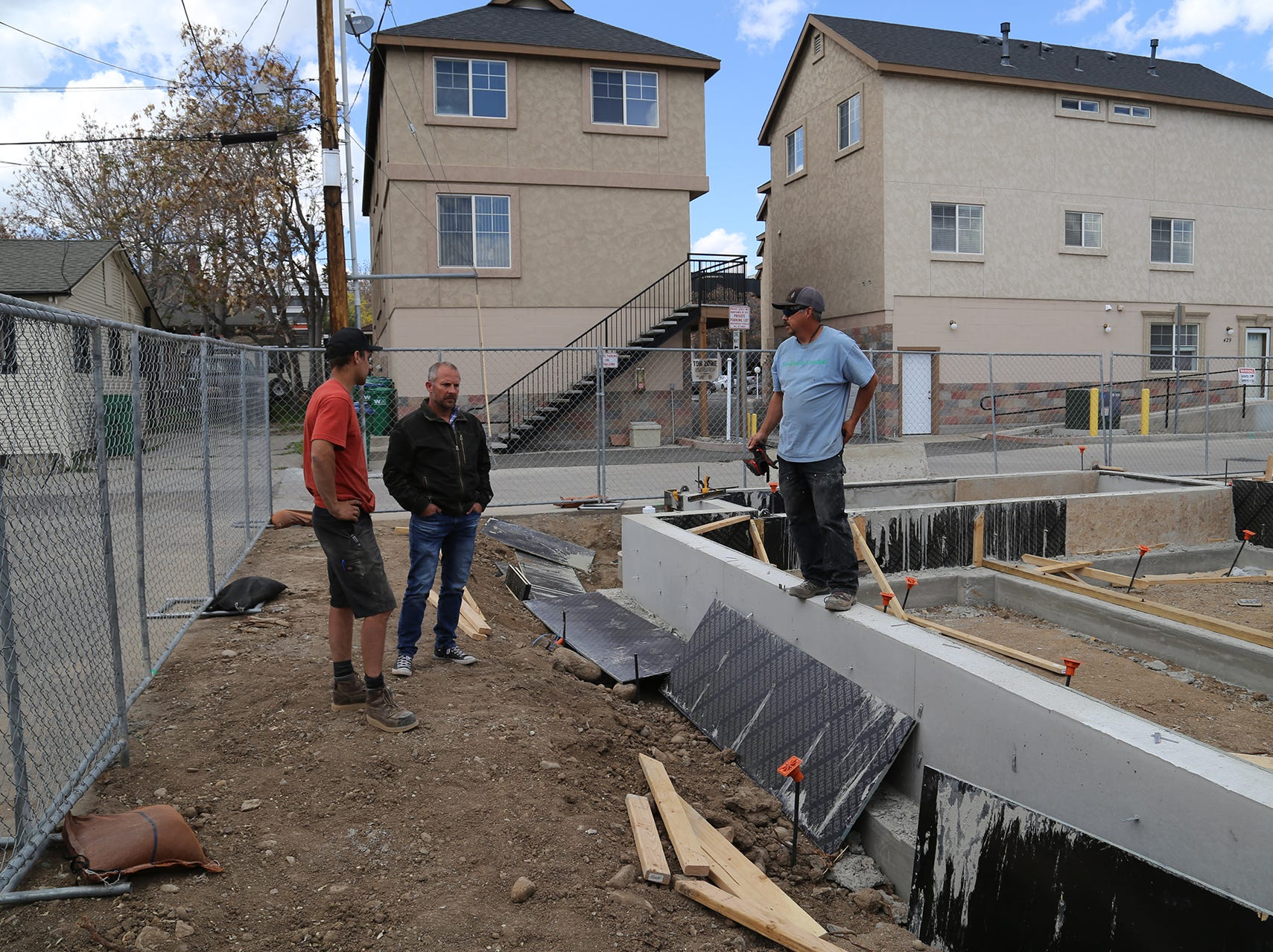 Bryan Raydon of Marmot Properties surveys the foundation of a new shipping container apartment project at Midtown Reno on Holcomb Avenue and Moran Street on April 29, 2019.