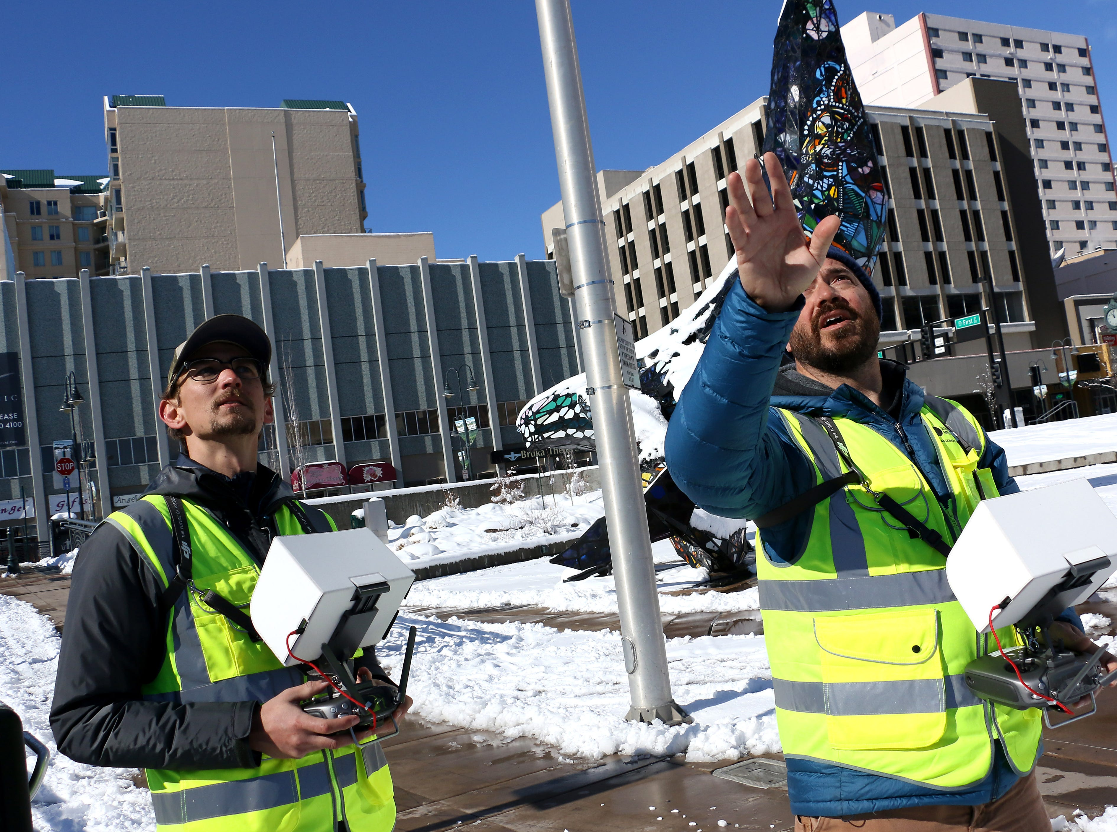 The Reno Gazette Journal drone pilots Ben Spillman, right, and Sam Gross are seen working in Reno's City Plaza on Feb. 10, 2019.