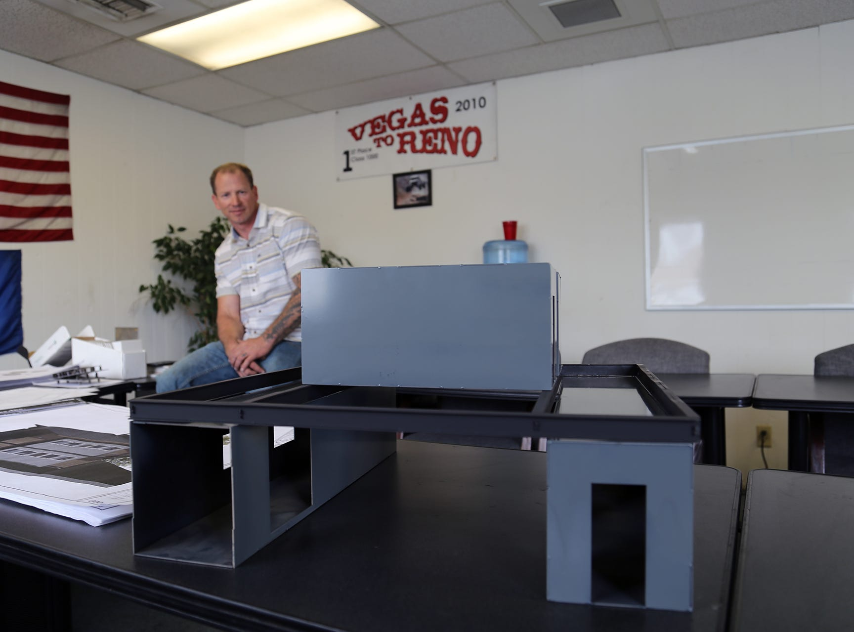 Chad Giguiere, owner of Twisted Metal in Reno, shows off the modular nature of his concept for shipping container-based housing.