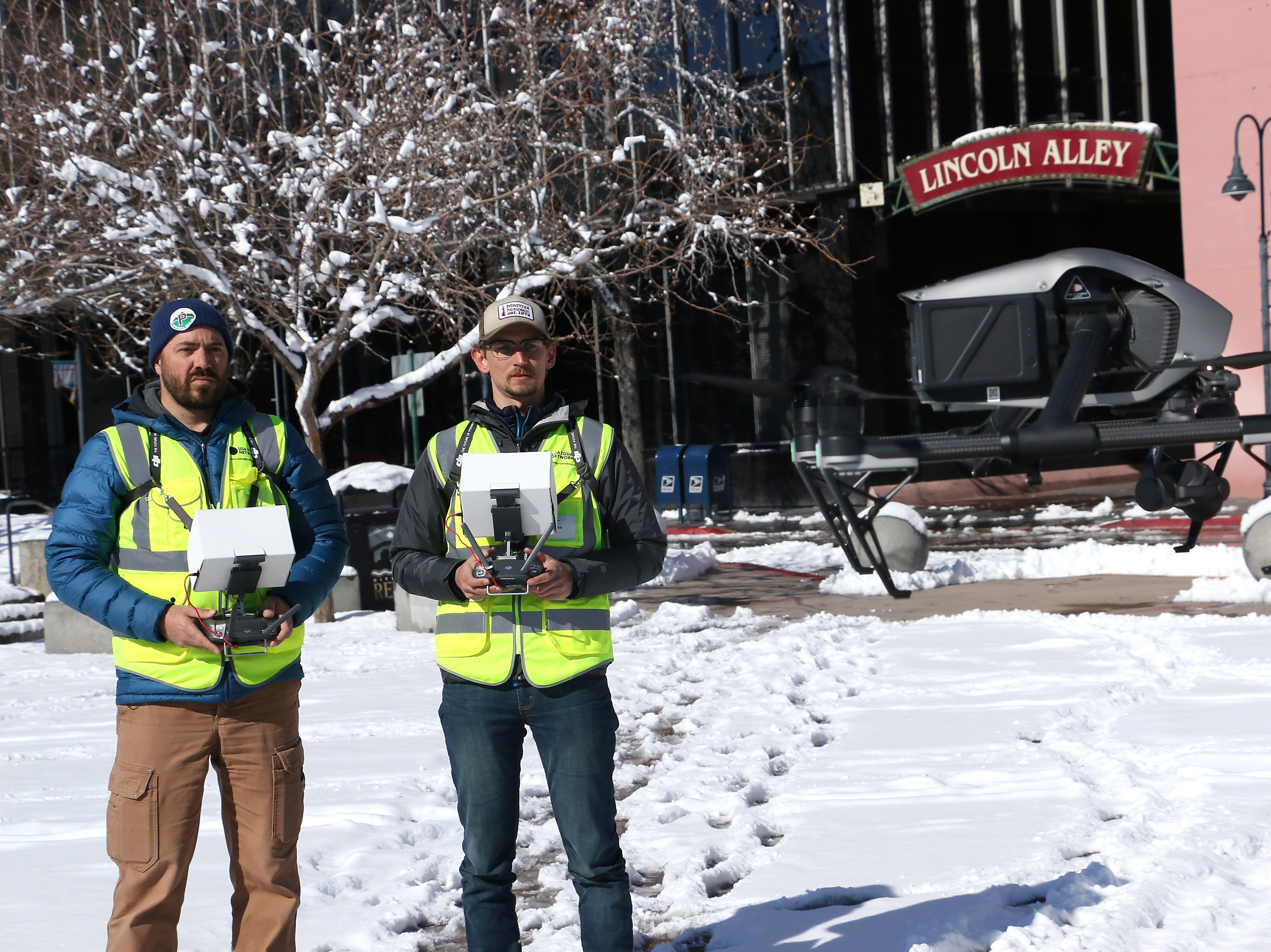 The Reno Gazette Journal drone pilots Ben Spillman, left, and Sam Gross are seen working in Reno's City Plaza on Feb. 10, 2019.