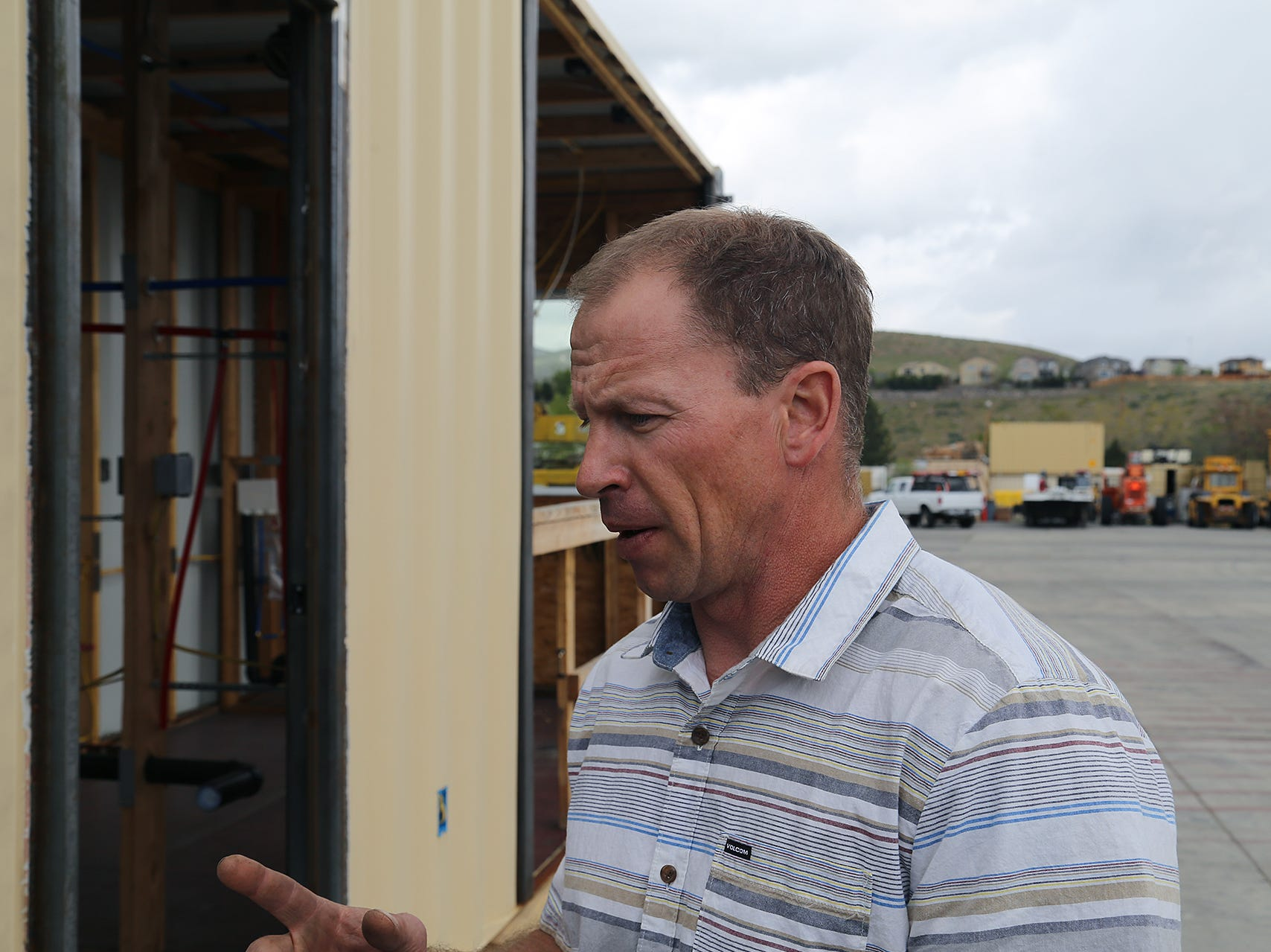 Chad Giguiere, owner of Twisted Metal in Reno, shows off his concept for shipping container-based housing on April 30, 2019.