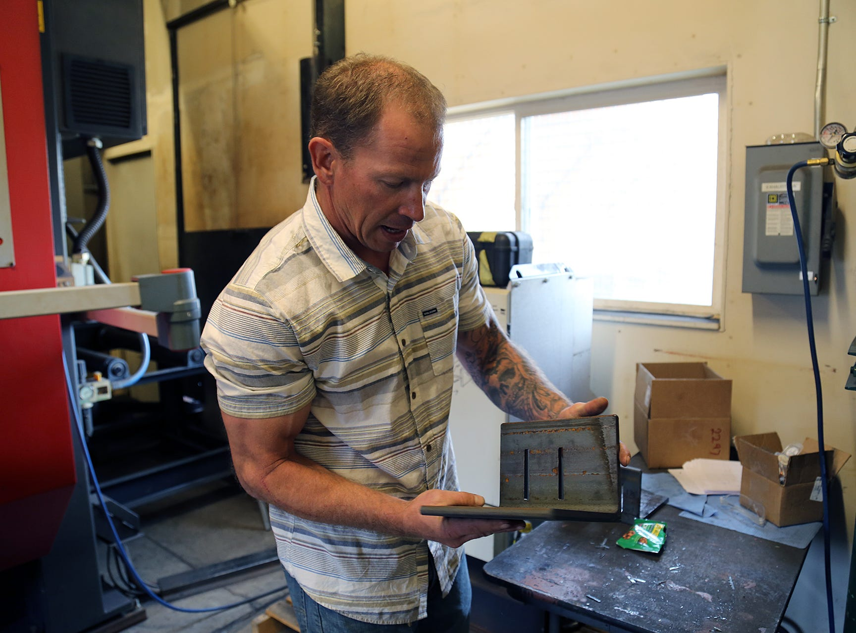 Chad Giguiere, owner of Twisted Metal in Reno, shows off one of the pieces created on a Python X CNC steel fabrication system for his shipping container-based housing concept on April 30, 2019.