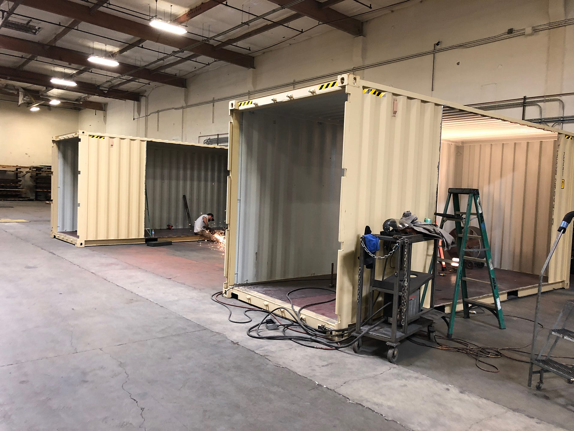 A worker at Twisted Metal in Reno works on of the company's concepts for shipping container-based housing.