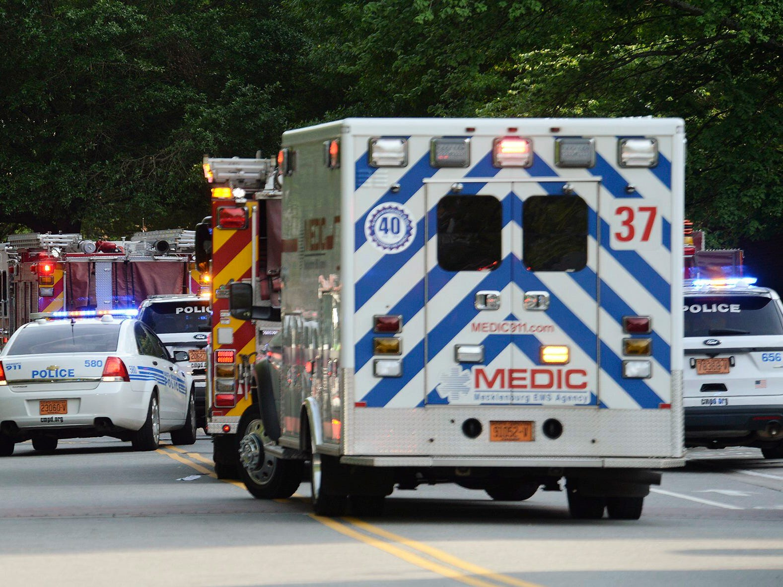Emergency vehicles cluster on Mary Alexander Road on the campus of University of North Carolina at Charlotte after a shooting Tuesday, April 30, 2019, in Charlotte, N.C. The shooting on the campus left at least a few people dead and several wounded Tuesday, prompting a lockdown and chaotic scene in the state's largest city.