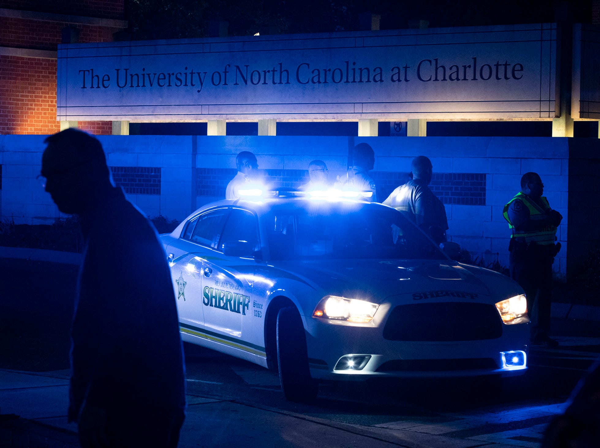 Police secure the main entrance to UNC Charlotte after a fatal shooting at the school, Tuesday, April 30, 2019, in Charlotte, N.C.