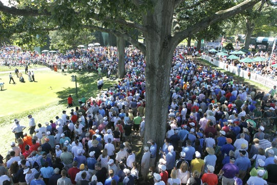 Crowds gather at the first and 14th tees during the third round of the 95th PGA Championship at Oak Hill Country Club  on Aug. 10, 2013.