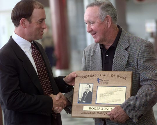 Roger Bunce, right, during his induction as a charter member of the Section V Football Hall of Fame.