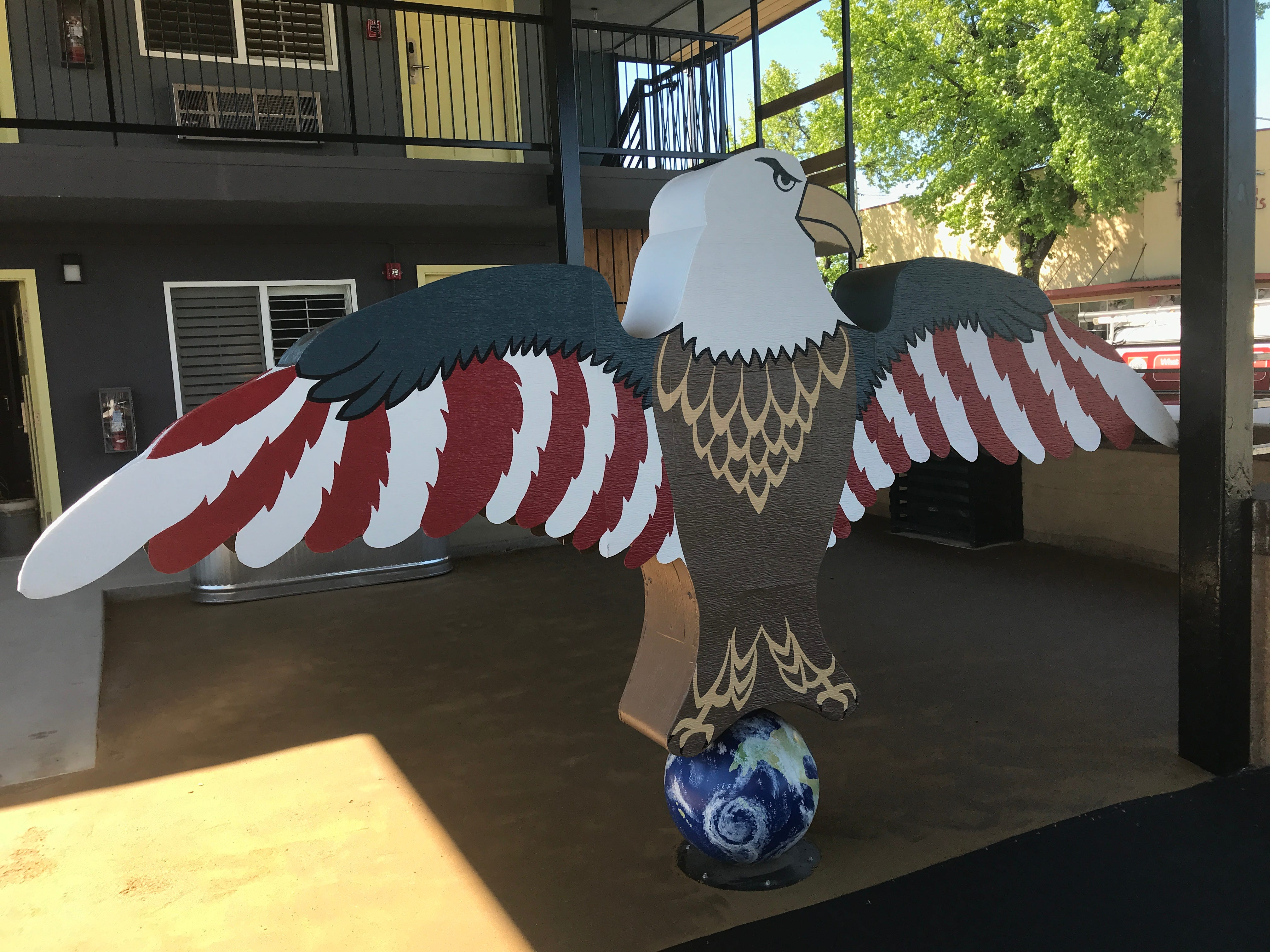 This is the eagle that used to be perched atop the old Americana Lodge sign. It has been repainted and placed near the Market Street entrance.