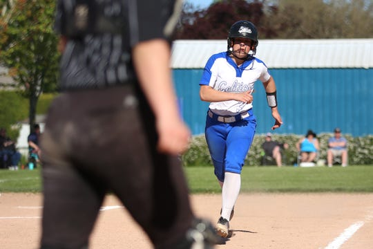 McNary's Taylor Ebbs (3) complets a run during a Summit vs. McNary 6A softball game at McNary High School in Keizer on April 30, 2019.