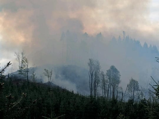Smoke rises from a wildland fire near McMinnville Tuesday evening.