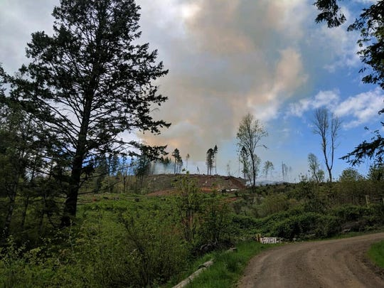 Smoke rises near a wildland fire outside of McMinnville Tuesday, April 30, 2019.