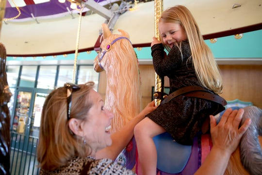 Charlotte Jones, 3, rides Sweet Pea, a llama figure, with her grandma, Catherine Jones, of Keizer, at the Riverfront Carousel in Salem on April 29, 2019.