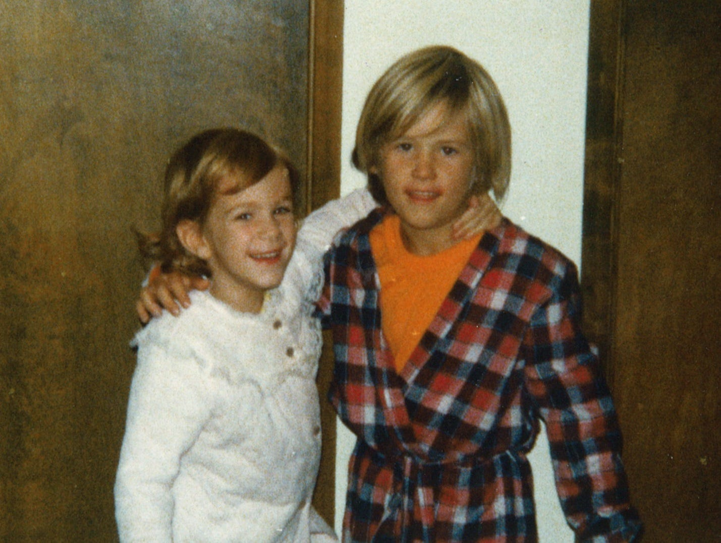 Halverson, around 6 in this photo with little sister Tiffeny, grew up in Salem.
