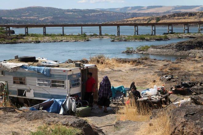 This Aug. 22, 2014, file photo shows the home of Ranetta Spino and her family at the river's edge at Lone Pine, a Native American fishing site on the Columbia River near The Dalles, Ore.