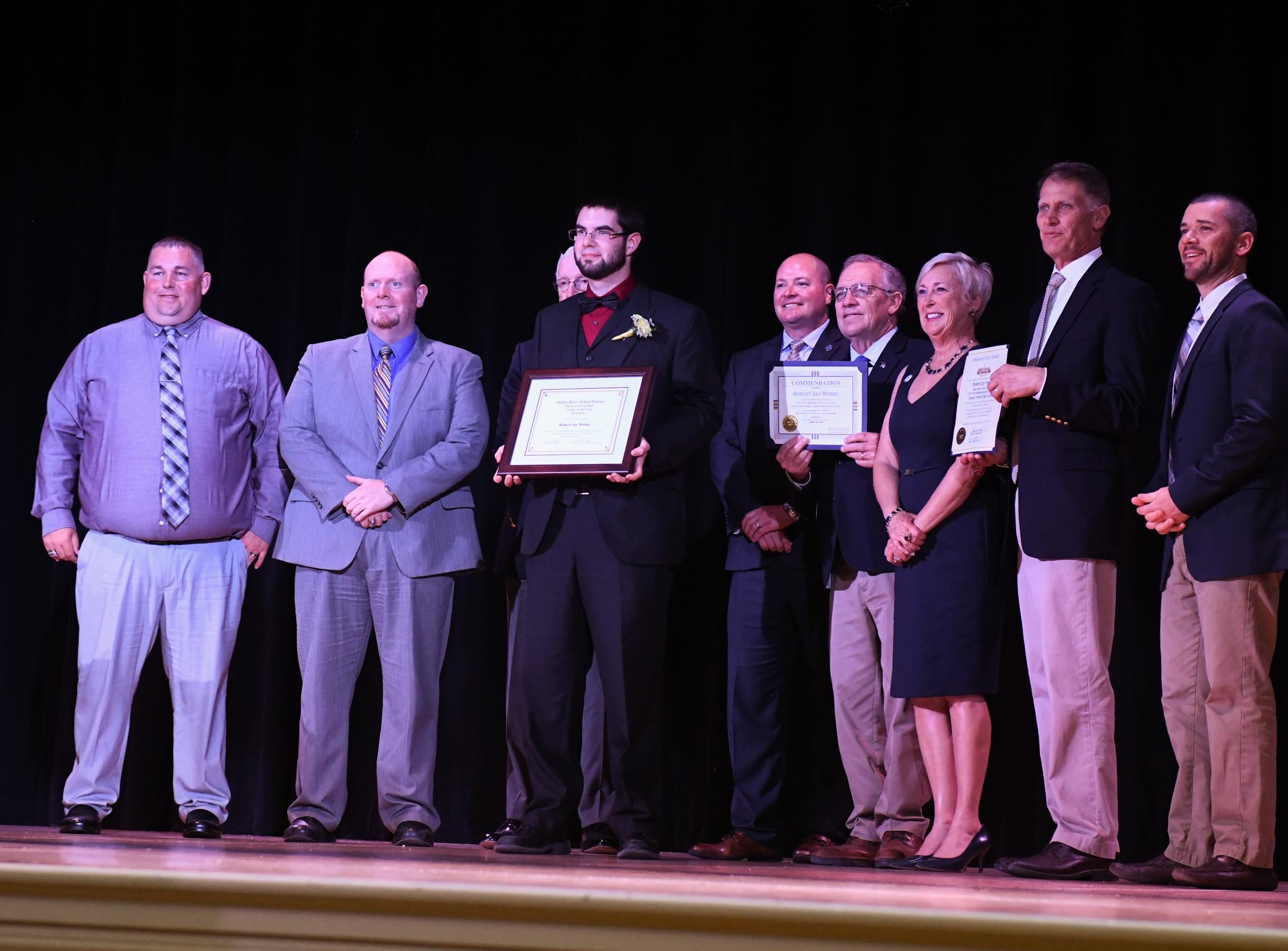 Robert Weber, Sussex Central High School, receives his award for the teacher of the year at his school on Tuesday, April 30, 2019.