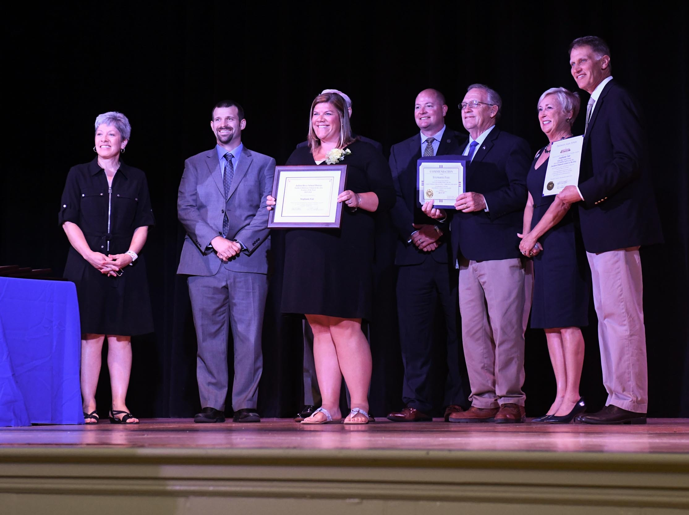 Stephanie Fair, Southern Delaware School of the Arts, receives her award for the teacher of the year at her school on Tuesday, April 30, 2019.