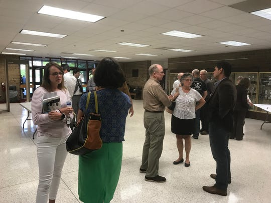 Attendees talk after a presentation by the Virginia Department of Environmental Quality on Tuesday, April 30, 2019 in Onley, Virginia about draft groundwater withdrawal permits for 54 poultry operations in Accomack County.