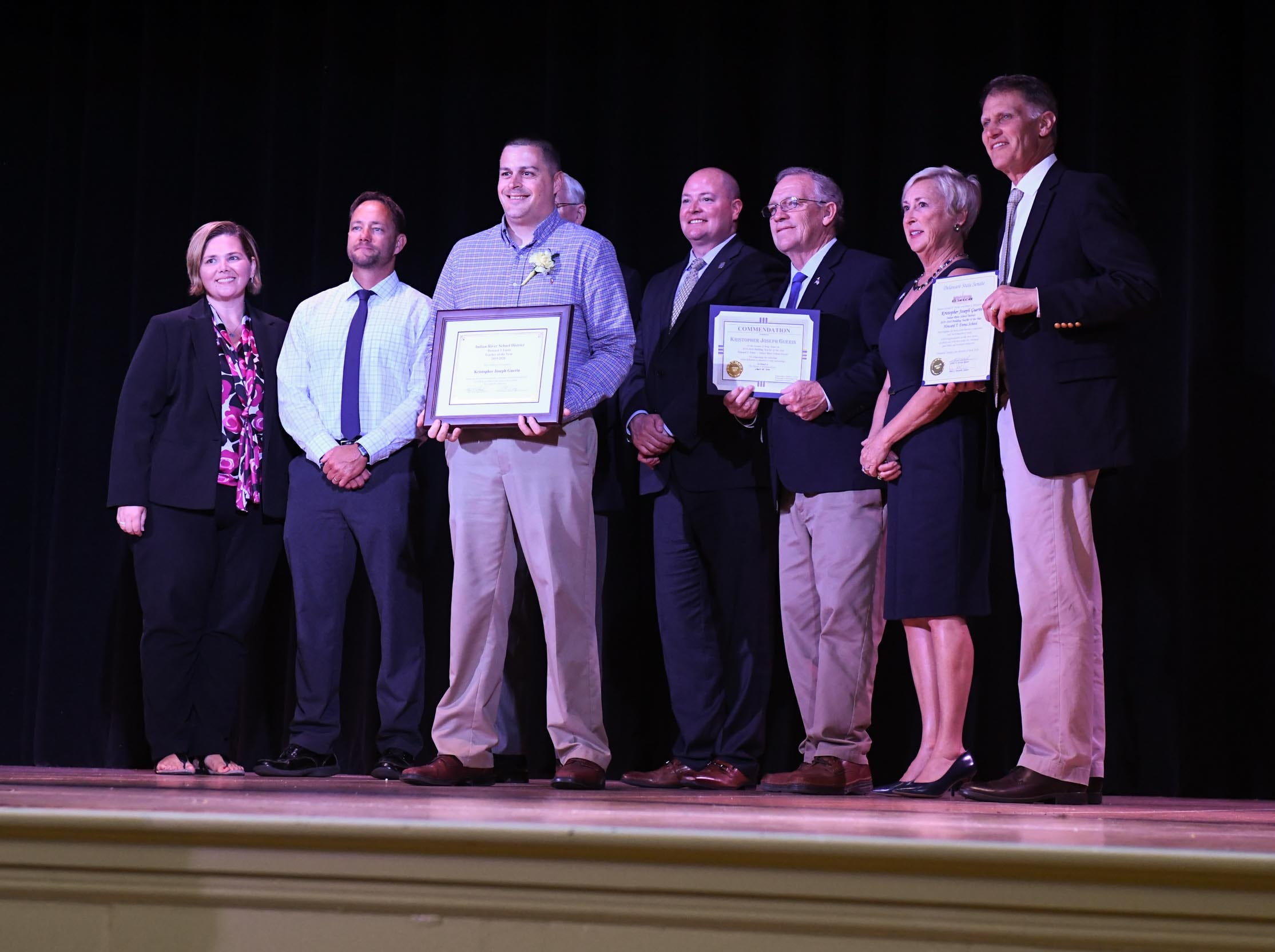 Kristopher Guerin, Howard T. Ennis, receives his award for the teacher of the year at his school on Tuesday, April 30, 2019.