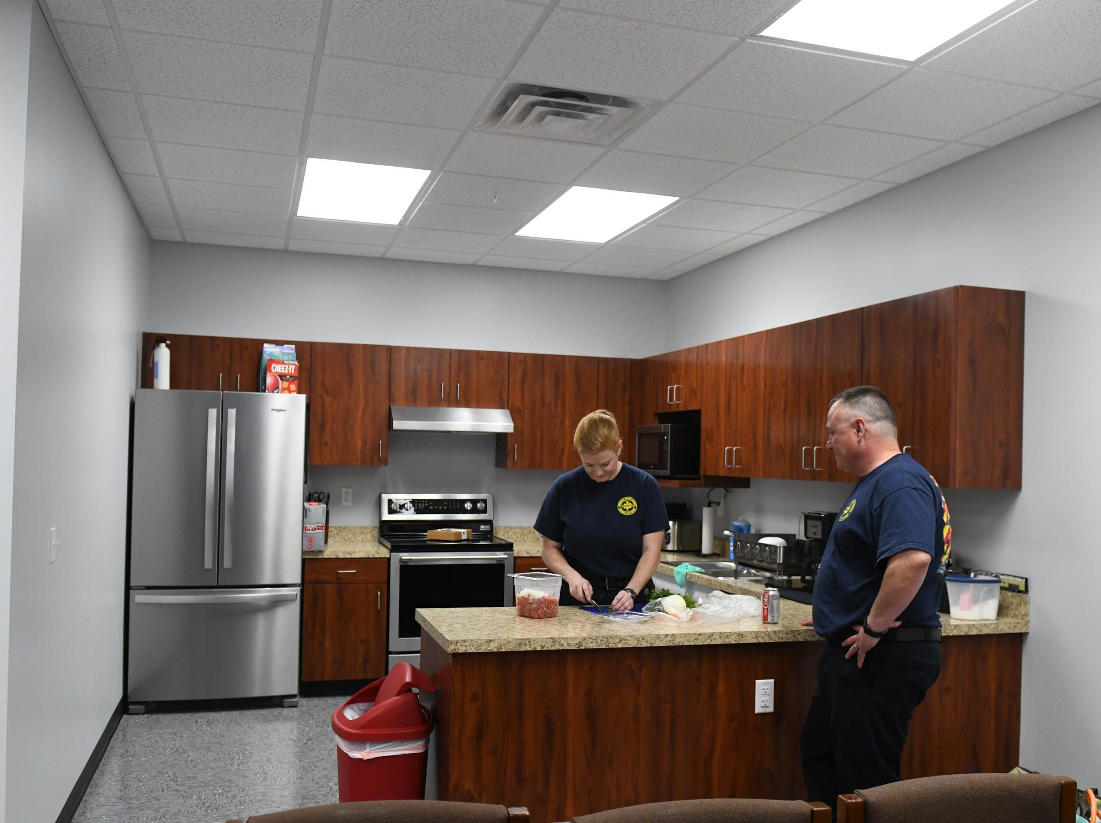 Chincoteague EMS personnel Alexis Witzke and Paul Savage prepare dinner for the first time in the new Chincoteague Volunteer Fire Department located at 5175 Chicken City Road on Wednesday, May 1, 2019