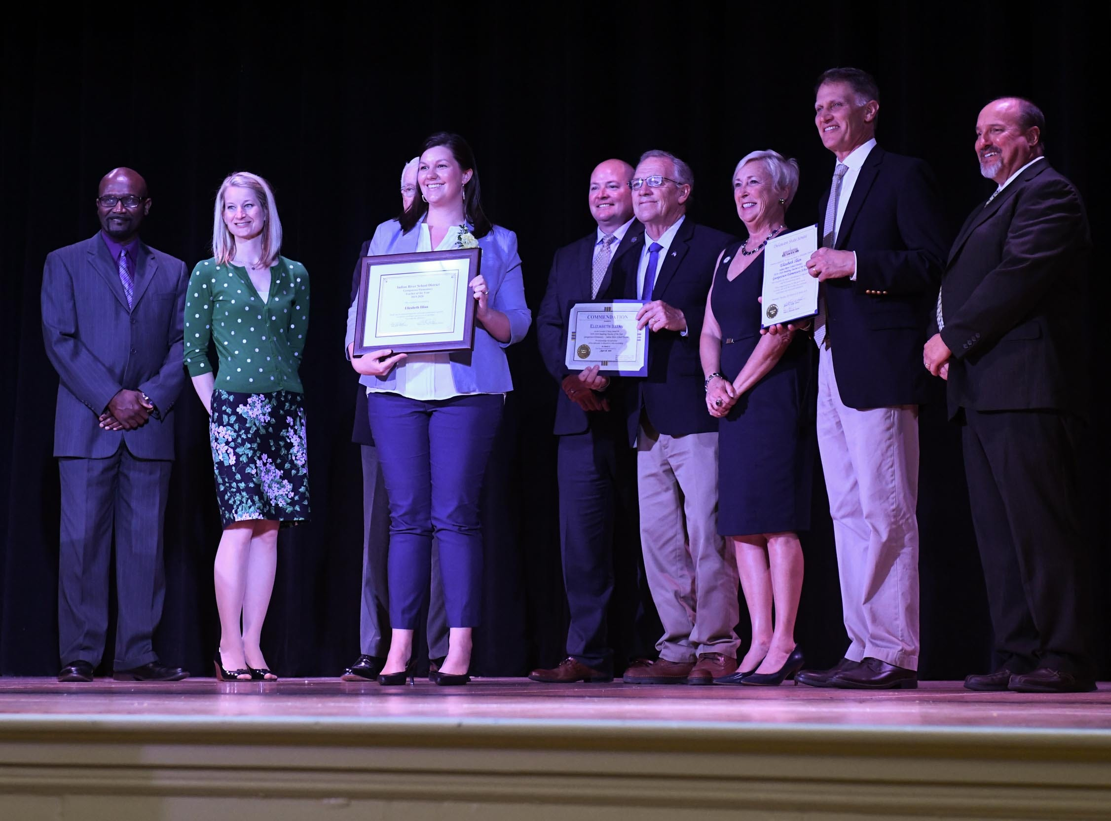 Elizabeth Illian, Georgetown Elementary, receives her award for the teacher of the year at her school on Tuesday, April 30, 2019.