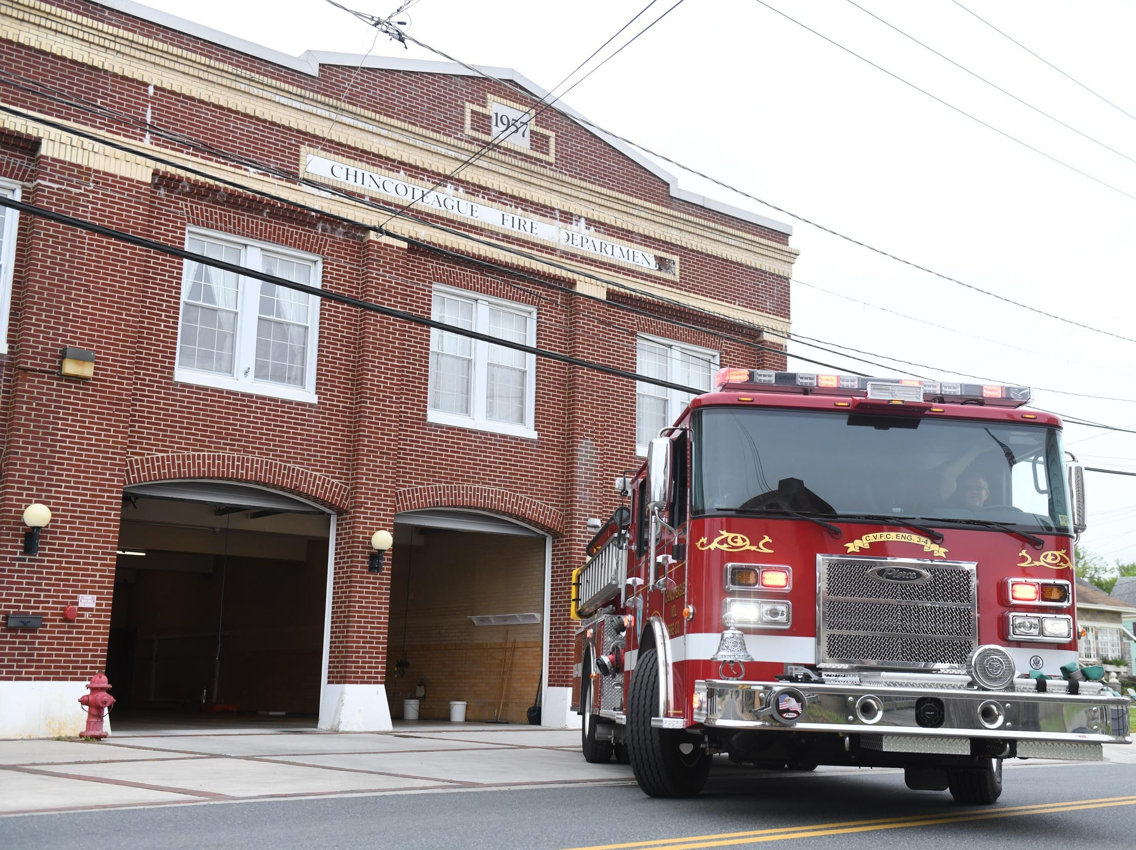 The Chincoteague Volunteer Fire Department drives the fire truck out of the old building for the last time on Wednesday, May 1, 2019.