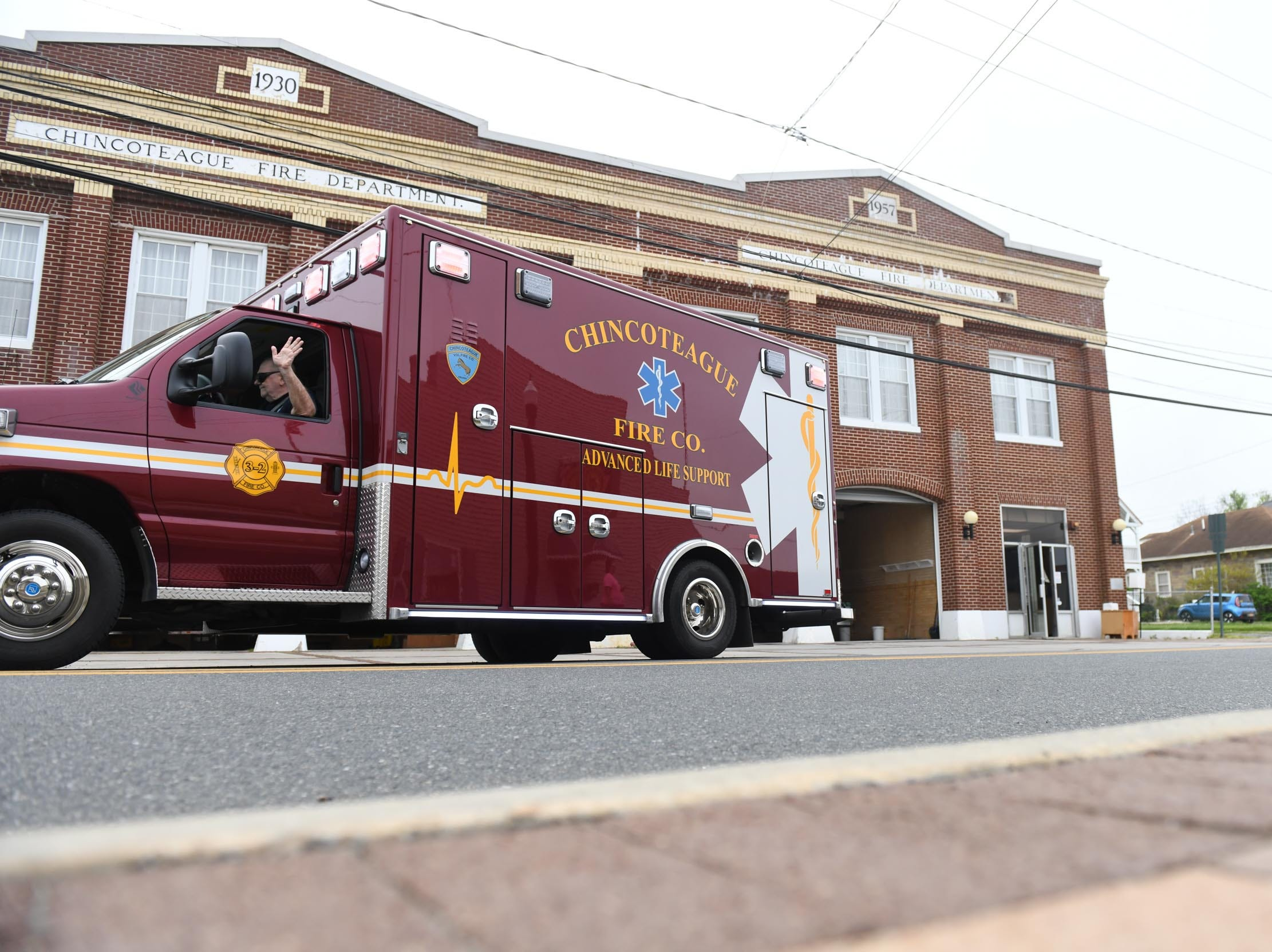 The Chincoteague Volunteer Fire Department drives the ambulance out of the old building for the last time on Wednesday, May 1, 2019.