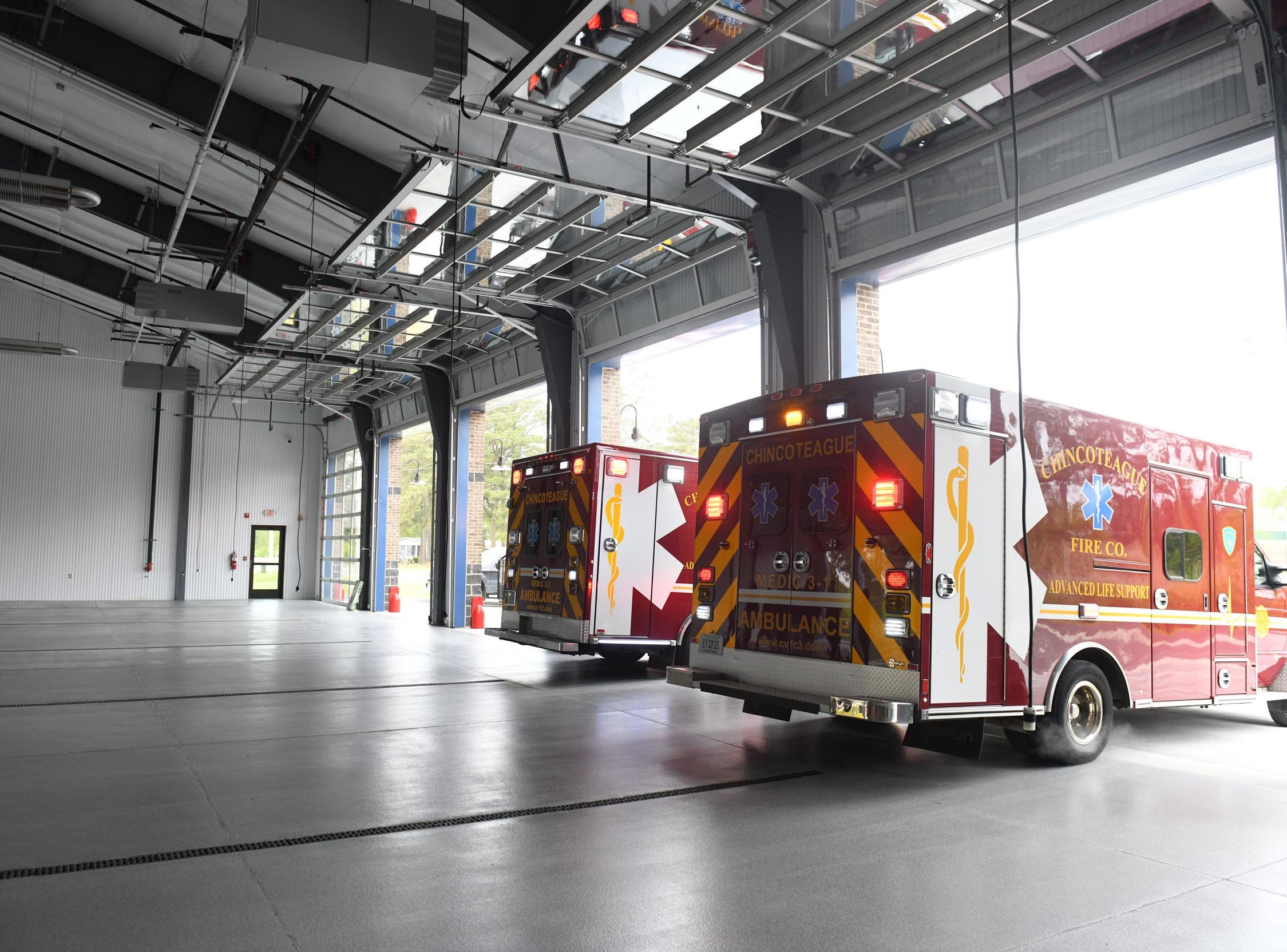 The Chincoteague Volunteer Fire Department backs in the ambulances for the first time, as they start the process of moving into their new location at 5175 Chicken City Road at on Wednesday, May 1, 2019.