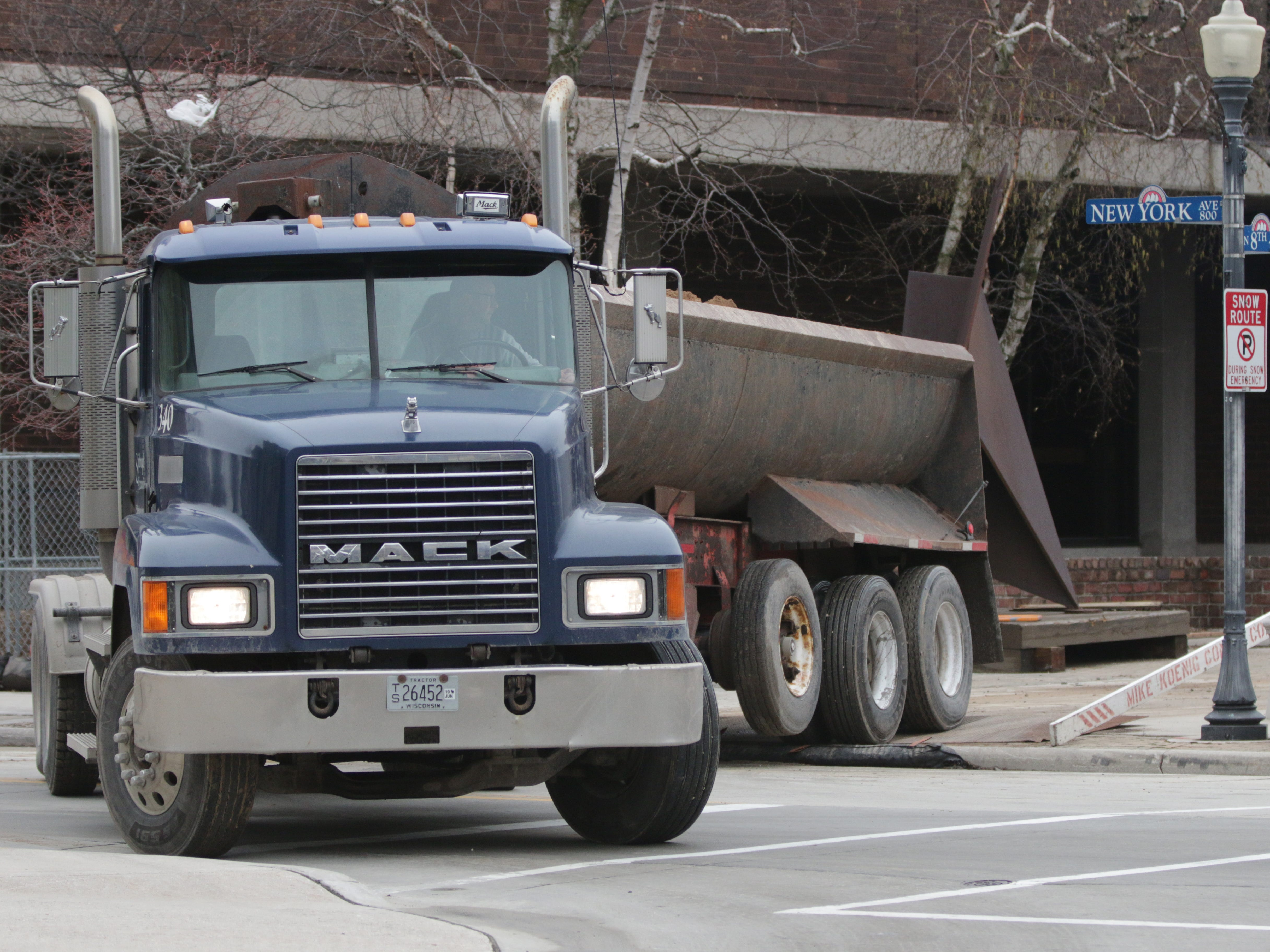 A construction truck hauls away materials from the Mead Public Library Plaza renovations as seen, Wednesday, May 1, 2019, in Sheboygan, Wis.