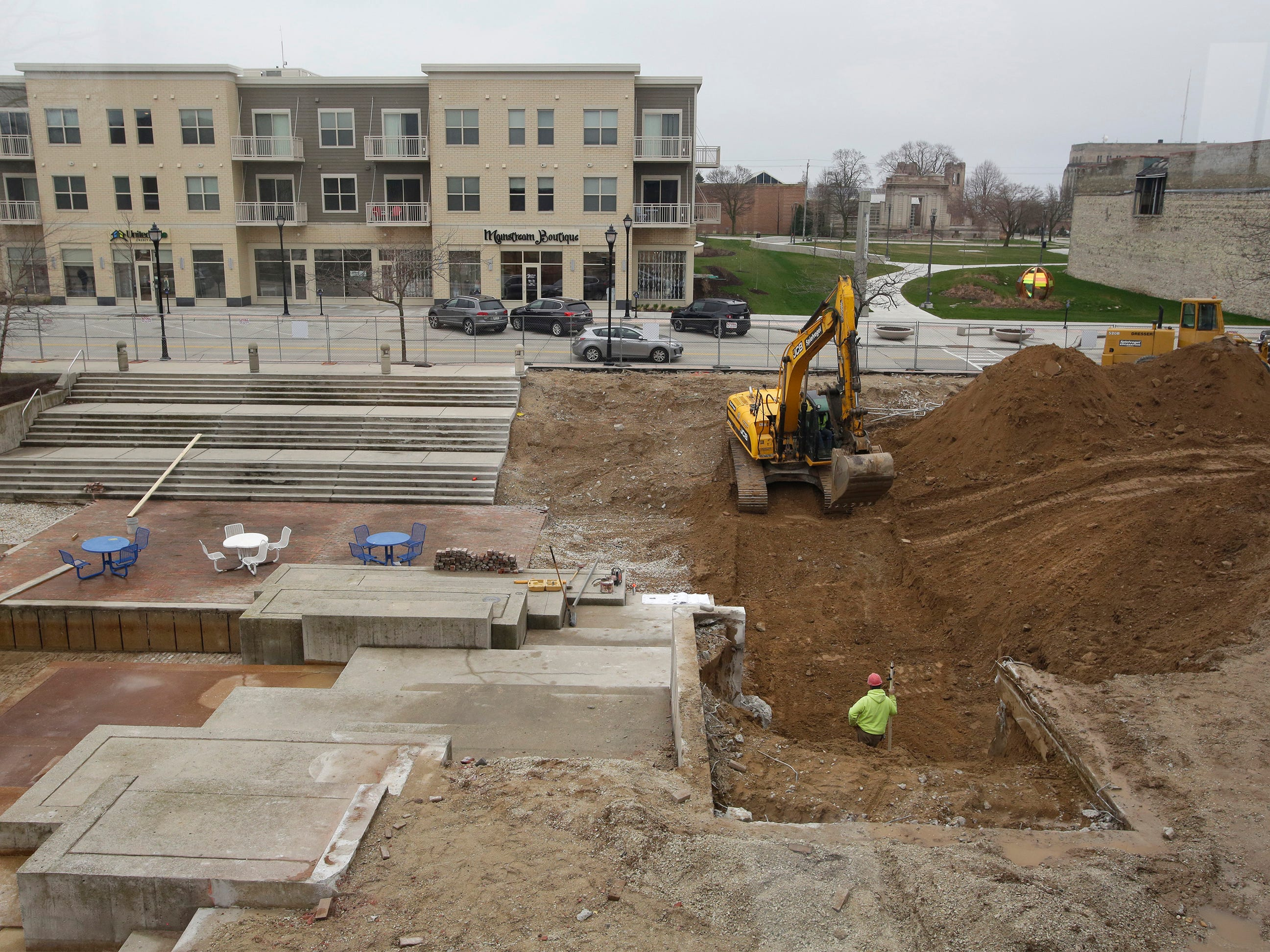 A view from inside Mead Public Library work being done on the Mead Public Library Plaza, Wednesday, May 1, 2019, in Sheboygan, Wis.